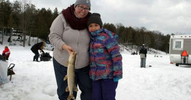 Ottawa's Sofia Groulx, 8, shows off her pike with mom Darquise Groulx who grew up in Kinburn. Photo by Jake Davies