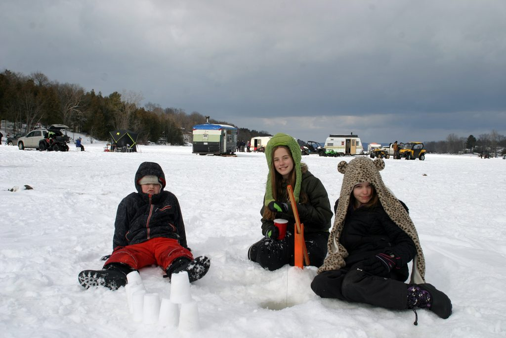 From left, Constance Bay's Geordie Nesbitt, 8, Sophia Efler-Murphy, 11, and Terilyn Nesbitt, 10, all of Constance Bay, watch their hole and build a snow castle. Photo by Jake Davies