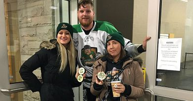 Dunrobin native Lexie York, far right with team owner-player Adrian Moyes and his wife Ashley, was back in the rink supporting the Rivermen at the team's first ever playoff game - an overtime thriller. Courtesy the Rivermen