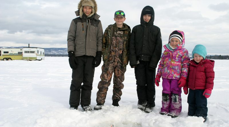 From left, Jordan Atherfold, 12, Cody Atherfold, 11, Nathan Pederson, 12, Grace Boyd, 6, and Hailey Boyd, 3, drop a hook at the WCFGC annual ice fishing derby last Saturday. Photo by Jake Davies