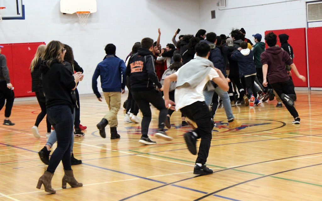 WCSS students storm the court following the final buzzer. Photo by Michelle Russett