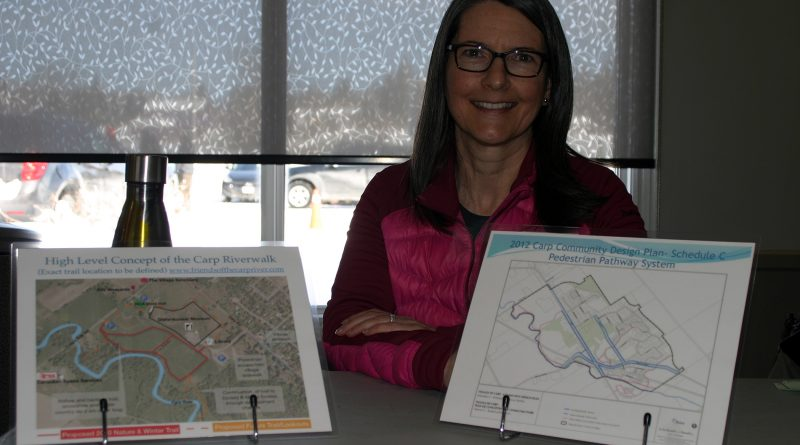 Friends of the Carp River board member Josee Leblanc spent the Carp Winter Carnival sharing information on a proposed to walking trail along a portion of the Carp River. Photo by Jake Davies