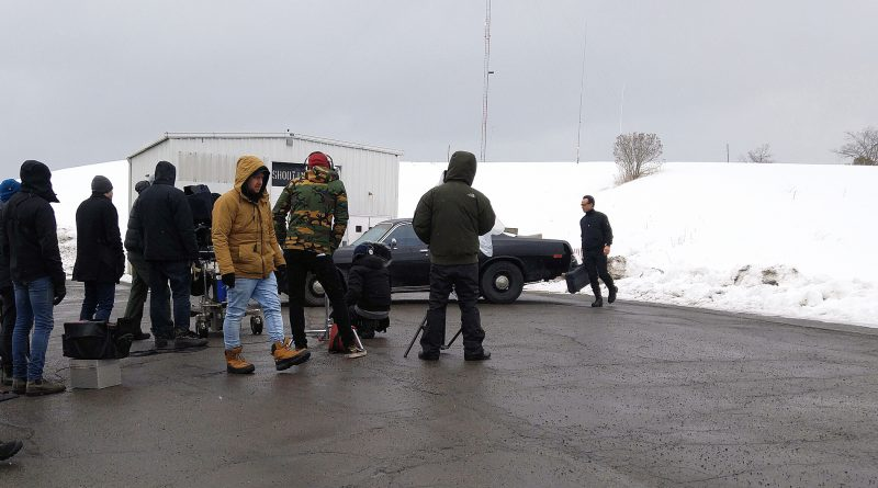 "Far right, actor Walton Goggins walks to his car before pulling out his cell phone and asking the famous hitman question, ""is there a problem?"" during filming at the Diefenbunker today. Photo by Jake Davies"
