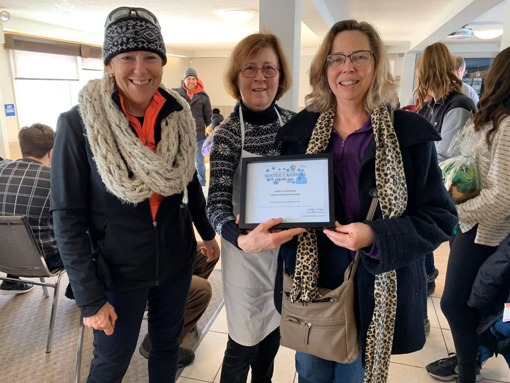 From left, HCA Carp Winter Carnival organizers Kathy Fisher and Judy Makin present chili contest winner Lori Gariepy with her certificate. Courtesy the HCA