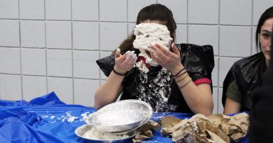 A WCSS Link Crew member gets the old pie-in-the-face during a Grade 9s birthday organized by the student organization. Photo by Michelle Russett