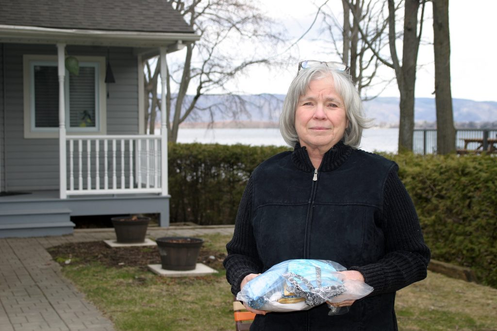 Constance Bay's Janet McKeen-Peterkin donates 14 scrub caps she made after hearing of the need. Photo by Jake Davies