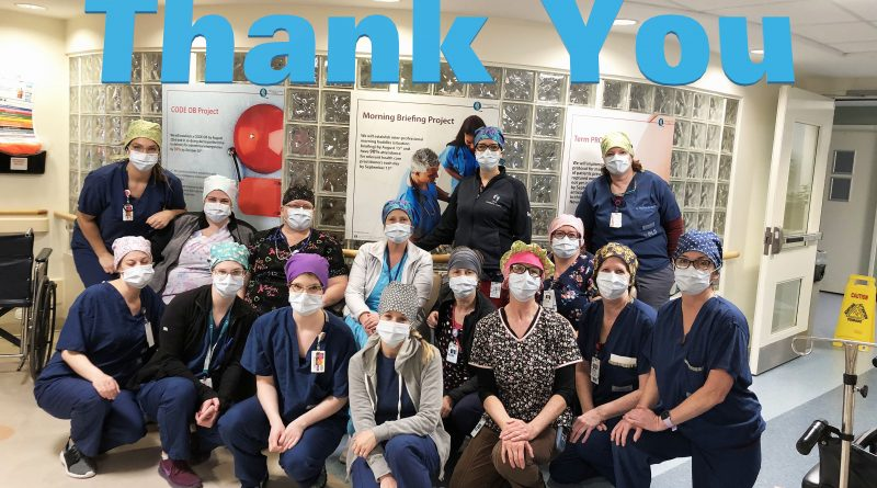 West Carleton nurse Tracey Zoobkoff and her colleagues in the Mother Baby Unit at the Queensway Carleton Hospital show off some of the scrub caps the community made for them. Courtesy Tracey Zoobkoff