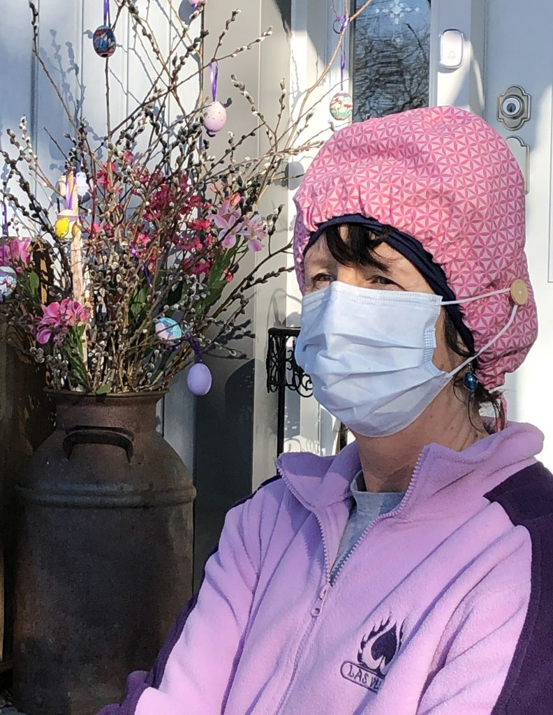 West Carleton's Tracey Zoobkoff shows off a scrub hat with buttons to help hold a surgical mask in place while giving her ears a break. Courtesy Zoobkoff