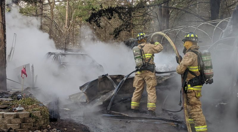 Fitzroy Harbour firefighters douse a garage fire on Carp Road Saturday morning. Courtesy Scott Stillborn/OFS