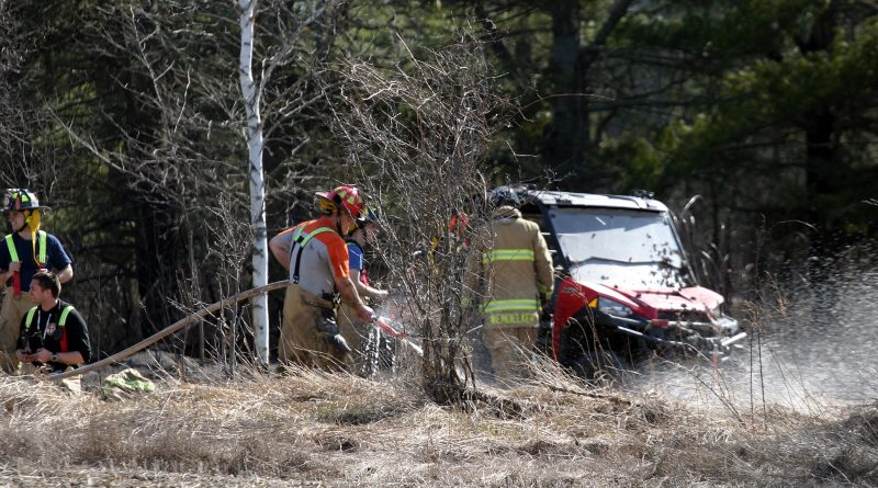 Ottawa firefighters responded to a record number of outdoor fire complaints in April despite a fire ban being in place. Above firefighters a tackle a bush fire near Galetta last week. Photo by Jake Davies