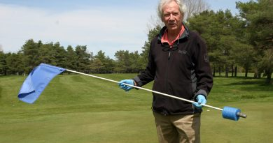 Madawaska Golf Club owner Rick Munro shows off the new flag sticks from the 18th green which prevent balls from going in to the hole. Photo by Jake Davies