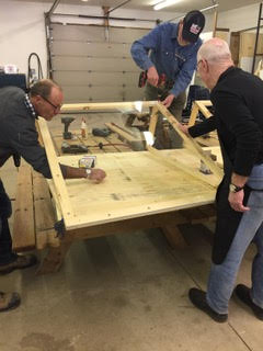 Men's Shed volunteers build protective shields for the hospital's active screeners. Courtesy ARH