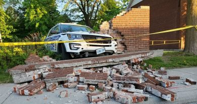 A suspect, fleeing in a police cruiser Monday, crashed through a wall driving through a park. Courtesy the OPS