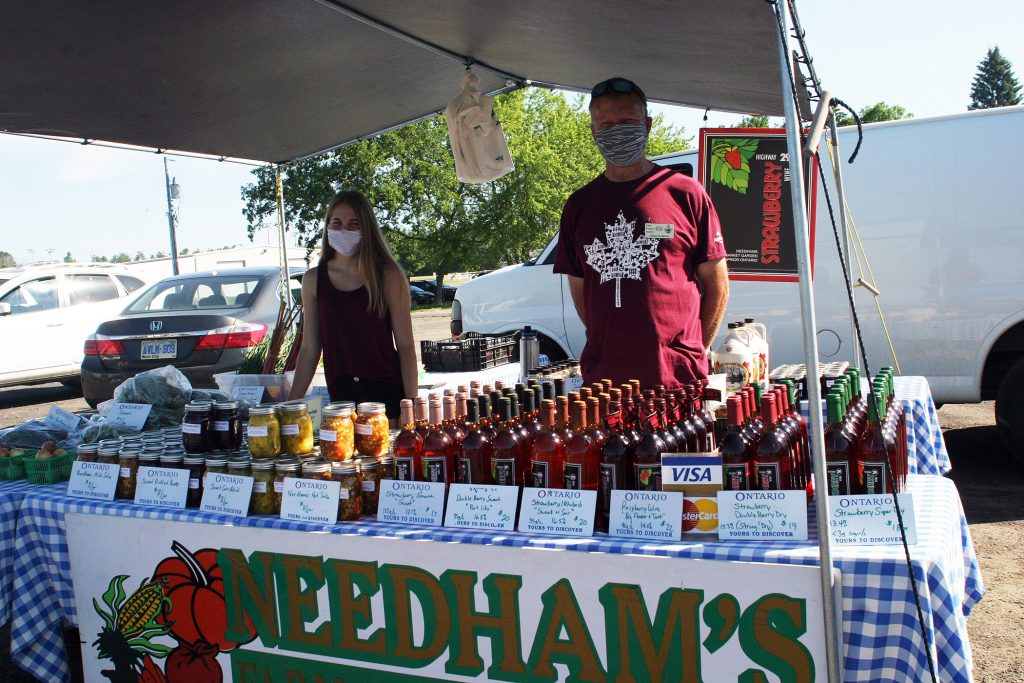 From left, Emma and Glenn Needham from Needham's  Market Garden had some of their famous Hwy. 29 fruit wines on sale. Photo by Jake Davies