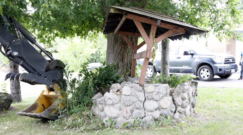 After roughly 50 years, two decorative wells greeting residents at Robertlee Drive were removed by city staff last week. Photo by Steve Fahie