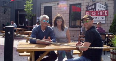 From left, Carl and Lesley Bertrand and Simon Vickery enjoy a cold pint on the Ridge Rock patio Friday afternoon. Photo by Jake Davies