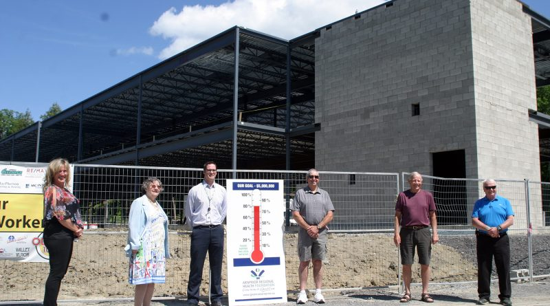 From left are ARHF board chair Jackie Asselin, ARHF board member and campaign liaison Jackie Laughlin, ARHF executive director Ben Gardiner, Arnprior Firefighters Fundraising Association Francis Herbert, campaign co-chair Ed Reid and campaign co-chair Glenn Arthur in the shadow of the new Grove extension. Photo by Jake Davies