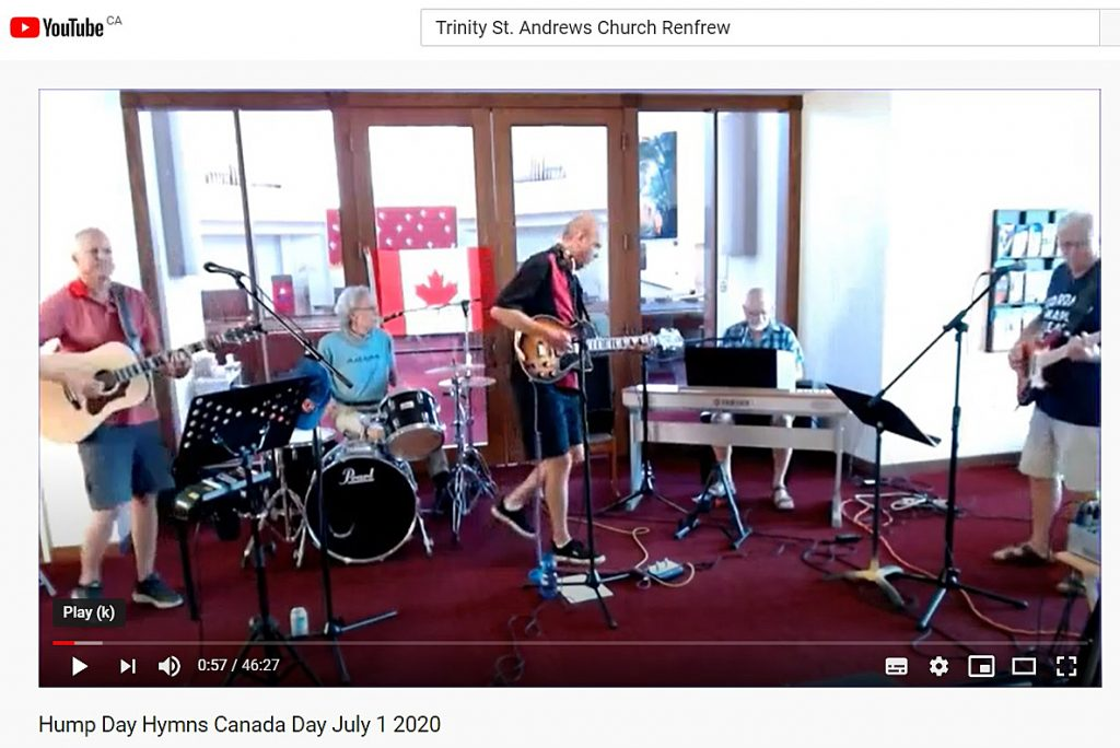 Mike McCormick (centre) of the Arrogant Worms, is also Trinity St. Andrew's music director, here performing the Mixed Nuts regular series Hump Day Hymns on Canada Day. Screengrab