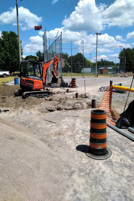 Volunteers work on installing a new fence around the diamond. Courtesy the U23 Canadian Fast Pitch Championship organizing committee