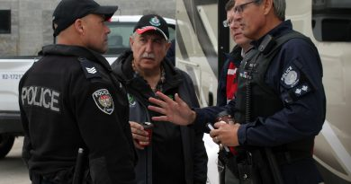 Coun. Eli El-Chantiry speaks with members of the Ottawa Police Service during extreme flooding in the spring of 2019. Crime in Ward 5 took a big dip in 2019 over 2018. Photo by Jake Davies