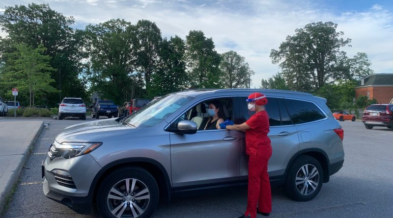 A WCFHT nurse administers an injection at the clinic's parking lot injection clinic. Courtesy the WCFHT