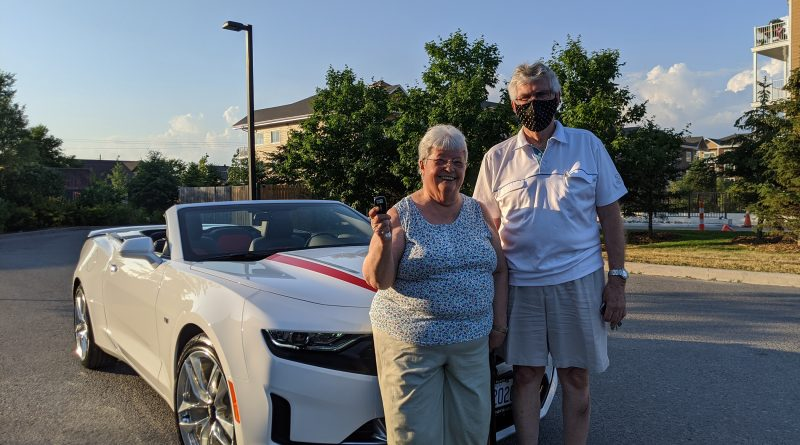 Audrey and Brian Kealy pose in front of their brand new convertible Camaro. Courtesy the AGH