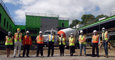 From left are Rujuta Kulkarni, Project Manager, ARH, John Gruno, Manager, Facilities, ARH, Brad Hilker, Vice President and CFO, ARH, Eric Hanna, President & CEO, ARH, John Yakabuski, MPP, Renfrew-Nipissing-Pembroke, Donna Anderson, Vice Chair, ARH Board of Directors, Dr. Merrilee Fullerton, Minister of Long-Term Care, Joseph Campbell, McDonald Brothers Construction, Gordon Downes, Turner & Townsend and Allesandro Guarna, McDonald Brothers Construction pose for a photo just in front of the construction zone. Photo by Jake Davies