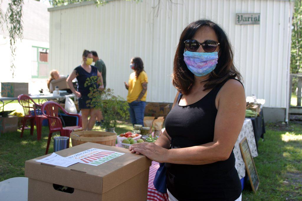Linda Hawkins picks up her CBCM Cheer Box last Saturday. Photo by Jake Davies
