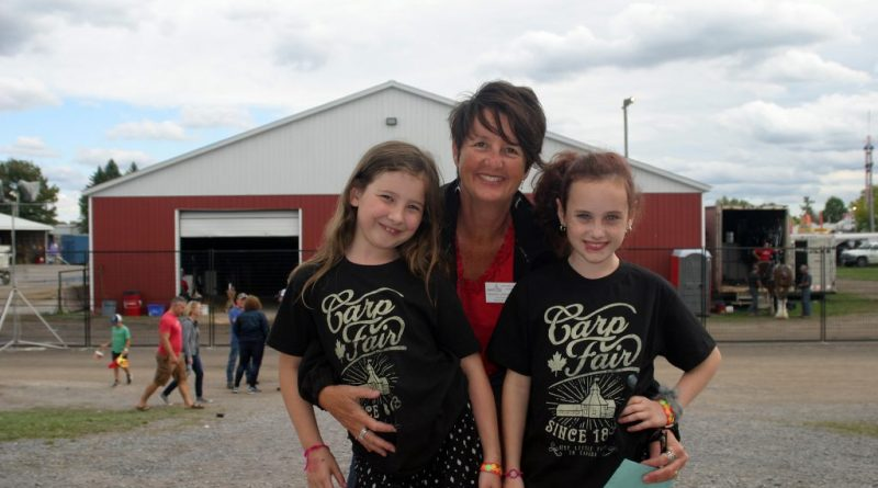 There won't be a Carp Fair this year but there will be a Carp Agricultural Society 2020 Showcase. Pictured past president Tracey Zoobkoff (2016) with future board members Kalina Zoobkoff, 9, and Etta Stevenage, 7 at the 2019 Carp Fair. Photo by Jake Davies