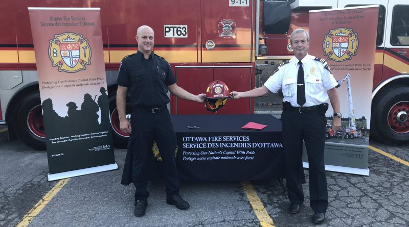 Constance Bay volunteer fire fighter Ian Bottriell, left, was promoted to lieutenant this evening in a ceremony presided over by District 6 Chief Bill Bell, right. Courtesy Bill Bell