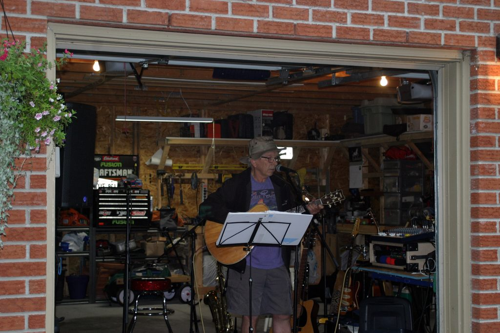 Musician Chris Hearn, a Morris Island resident, performs from the comfort of Jim Murray's garage. Photo by Jake Davies