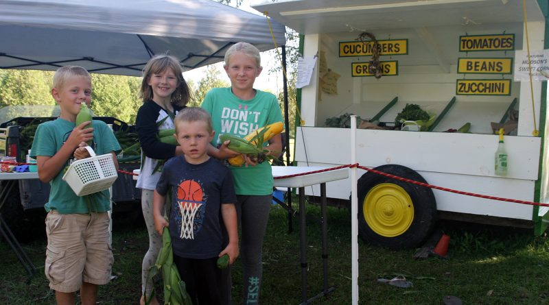 From left, William, Samantha, Harvey and Quinn Ross are operating a vegetable stand this season on Greenland Road. Photo by Jake Davies