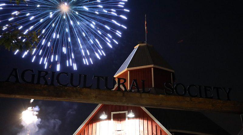 Fireworks explode above the Carp Fair exhibit hall.
