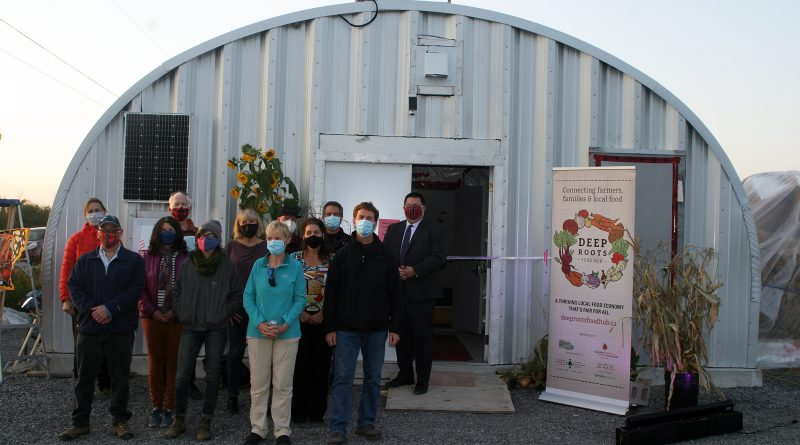 The Deep Roots Fod Hub board and supporters pose for a photo in front of the new root cellar.