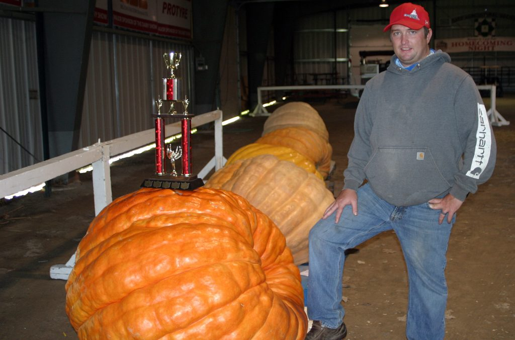 CAS director Charles Caldwell poses with some really big pumpkins.