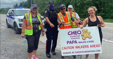 Beachburg's Russell 'Papa' Mackay, centre, will reach his destination of CHEO later today and will have raised close to $100,000 doing so. Courtesy Crystal Mackay