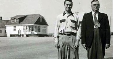 Bob Vance and his father Robert pose in front of their Woodlawn store.
