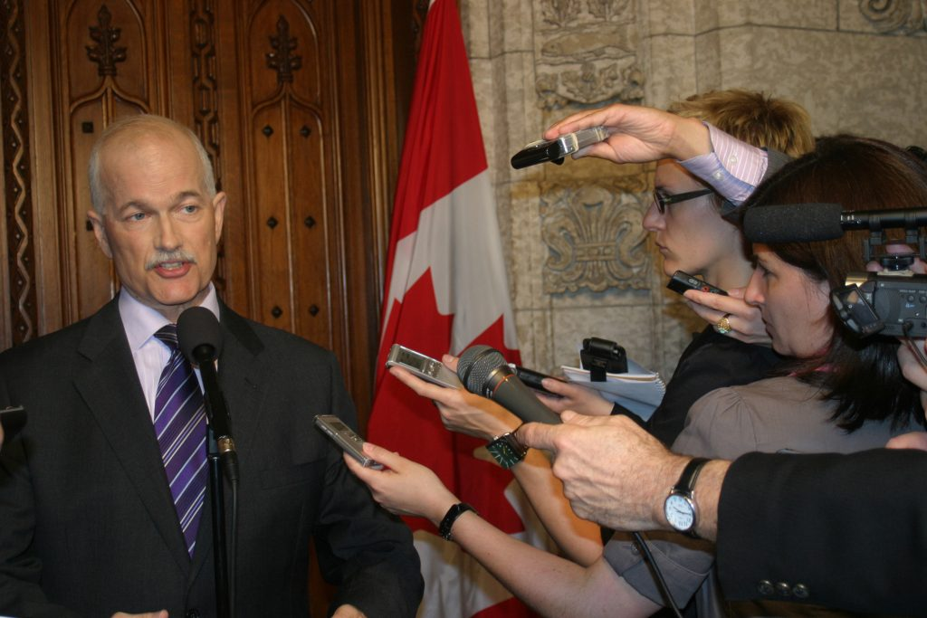 Jack Layton speaks to the media in 2011.
