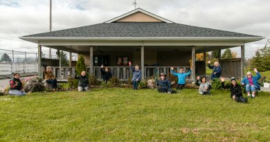 A photo of the Corkery Garden Club in front of the Corkery Community Centre.