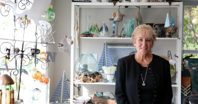 Artist Mary Teasdale in her boutiqe Moon Stones.