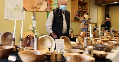 Woodturner John Chamney poses with his work during the Red Trillium Studio Tour.
