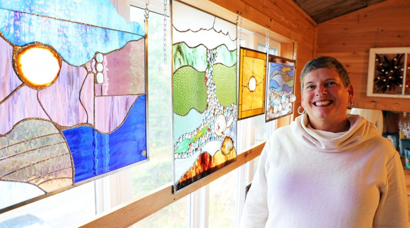 Stained glass artist Marlene Othmer and some of her work.