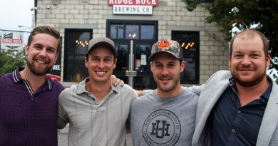A photo of the Ridge Rock owners in front of the restaurant.