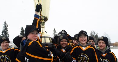 The Warriors celebrate winning the Good Deeds Cup.
