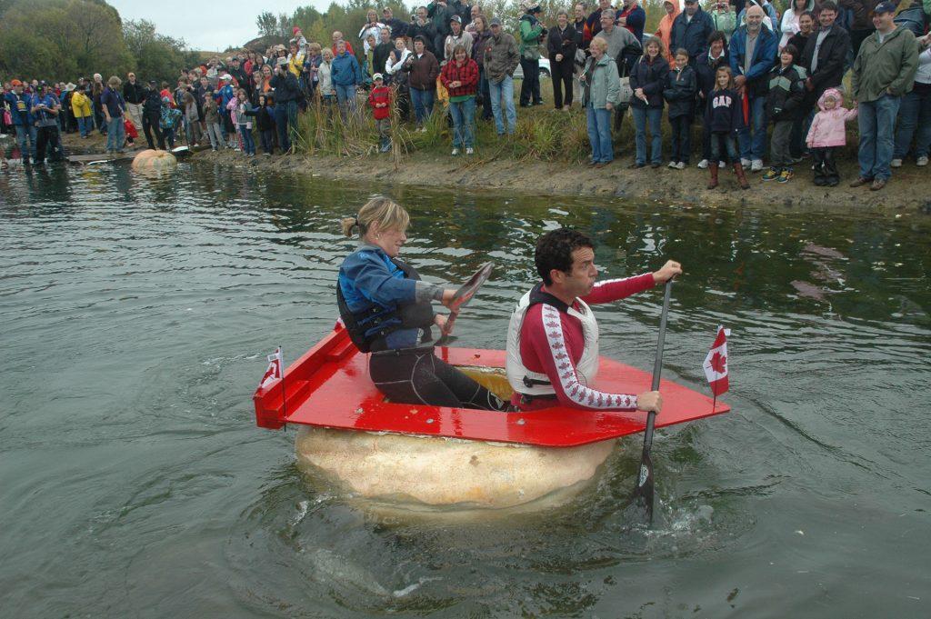 Rick Mercer paddles a pumpkin.