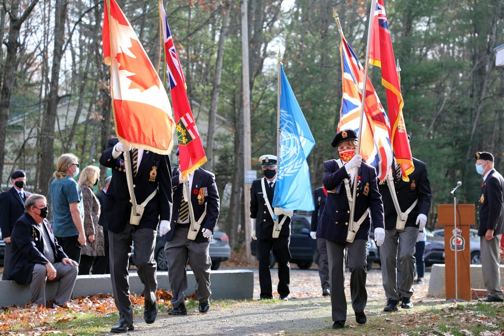 The Branch 616 Colour Guard approaches the cenotaph at the beginning of Satruday's service.