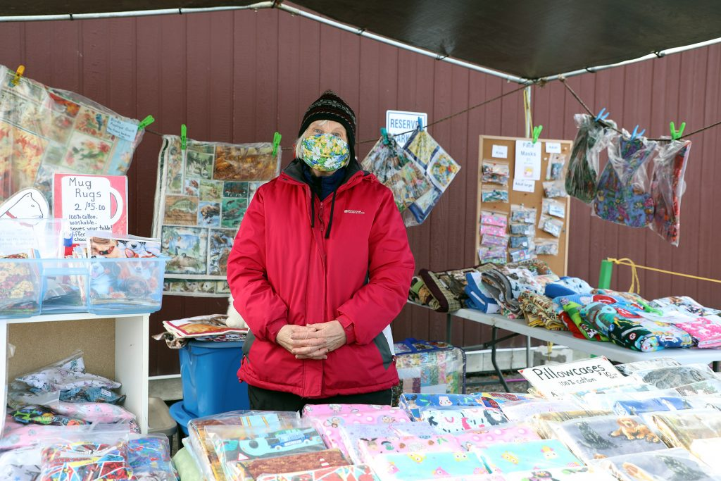 Woodlawn's Barb Hare poses in her Carp Farmers' Market booth.