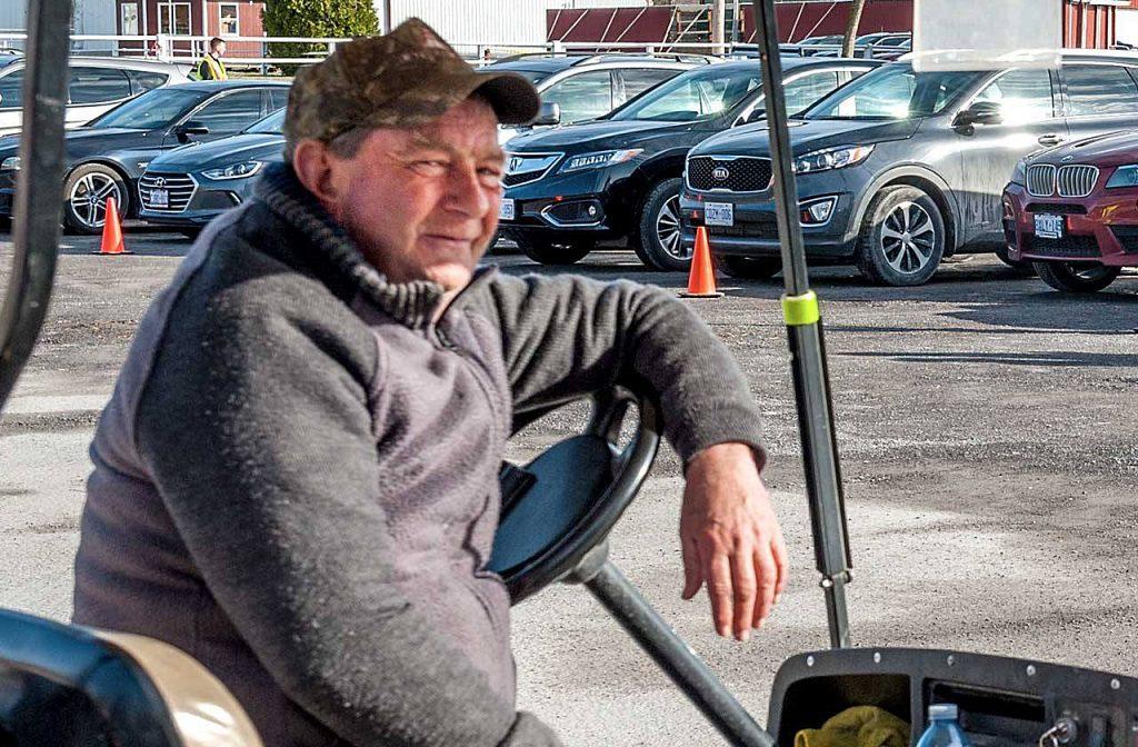 Dave Creighton in his beloved golf cart.