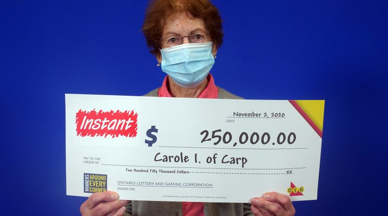 Carp's Carole Ittermann poses with her big cheque.