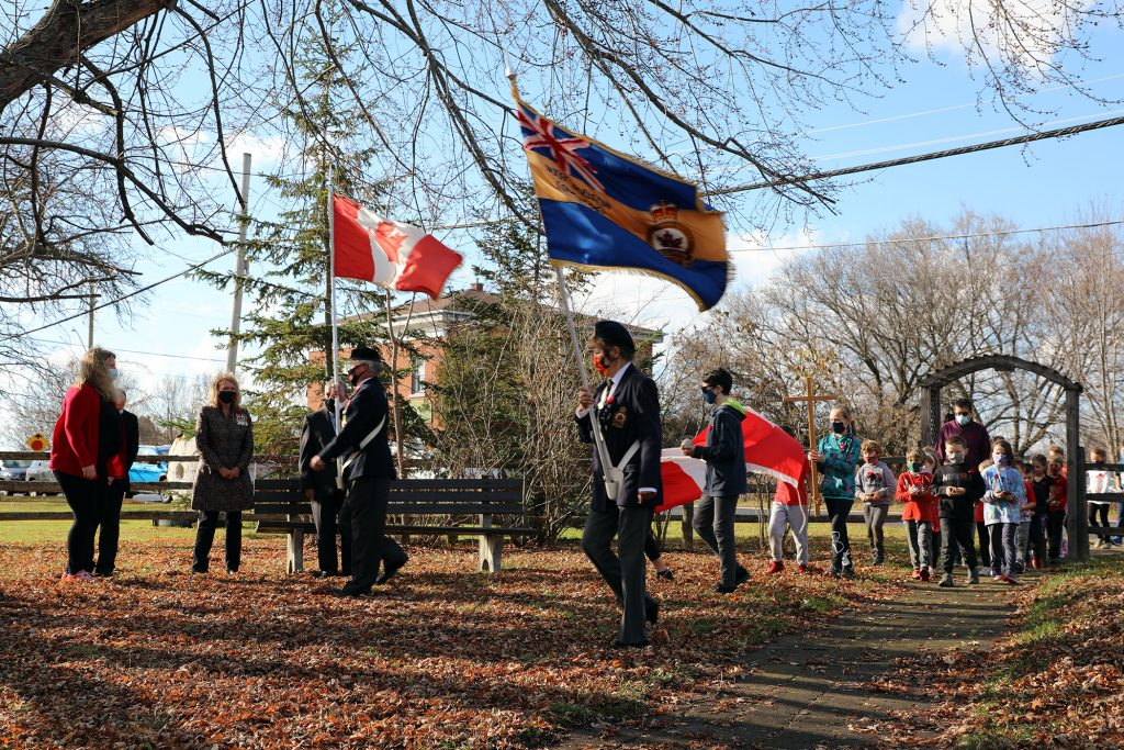 St. Michael's students are led in to Memorial Park by the Branch 616 Colour Guard.